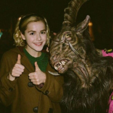 A photo of Sabrina the Teenage Witch next to a demon.